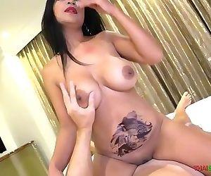 Big tit Asian MILF rides..