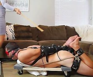 Hogtied, whipped, and caned..